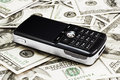 Mobile Phone on Dollars Royalty Free Stock Photo