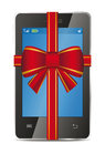 Mobile phone with gift red bow and ribbon Royalty Free Stock Image