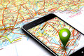 Mobile phone with gps and map in background Royalty Free Stock Photo