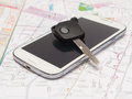 Mobile phone and key car on the map. Royalty Free Stock Photo