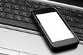 Mobile phone on laptop keyboard Royalty Free Stock Photography