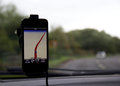Mobile phone navigation map attached to car windscreen app Royalty Free Stock Images