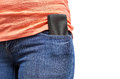 Mobile phone in a pocket of blue jeans. Isolated on white background Royalty Free Stock Photo