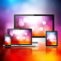 Mobile phone tablet pc laptop and computer over abstract background Stock Images