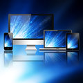 Mobile phone tablet pc laptop and computer over abstract blue background Stock Photo
