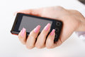 Mobile phone in women hand a female close up Royalty Free Stock Images