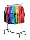 Mobile rack with color clothes on white background. File contains a path to isolation. Royalty Free Stock Photo