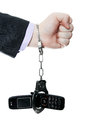 Mobile slavery the phone chained to a hand handcuffs Royalty Free Stock Image