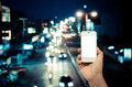 Mobile smart phone behind a blur of traffic Royalty Free Stock Photo