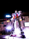 Mobile suit gundam model light show tokyo japan apr lights of the real scale robot from the japanese famous animation called at Royalty Free Stock Photo