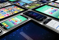 Mobility concept render of a collection of mobile devices tablets and smartphones Royalty Free Stock Image