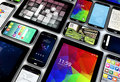 Mobility concept render of a collection of mobile devices tablets and smartphones with different screens Royalty Free Stock Images