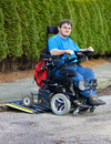 Mobility for infantile cerebral palsy patients caused by birth complications with a spastic young man in a multifunctional Stock Images