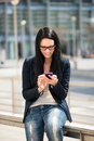 Mobility woman with smartphone young beautifull outdoor lifestyle portrait Royalty Free Stock Photography