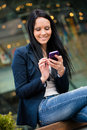 Mobility woman with smartphone young beautifull outdoor lifestyle portrait Royalty Free Stock Images