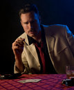 Mobster with cigar, playing poker Stock Photography