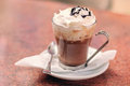 Mocha coffee with whipped cream and chocolate topping Royalty Free Stock Photos