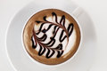 Mocha from top cup of coffee with paint on foam against white Royalty Free Stock Photo