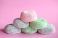 Mochi colorful japanese rice cakes stacked on pink Stock Images