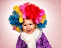 Mock baby little girl with clown wig mocking Stock Photo