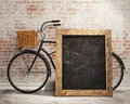Mock up black board in loft interior background with bicycle Royalty Free Stock Photo