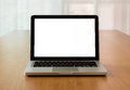 Mock up laptop with isolate screen on desk open wooden natural light coming through the window concept and idea Royalty Free Stock Photography
