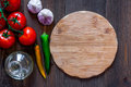 Mockup for menu. Cutting board and vegetables on wooden table background top view