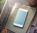 Mockup of white smartphone on the table. Clipping path Royalty Free Stock Photo