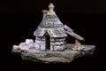 Model of an ancient italian abitation trullo tipical apulia black background Stock Photos