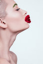 Model in a beauty shot with flower on white background Royalty Free Stock Photo