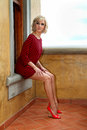 Model with black and red striped Bat wing sweater dress Royalty Free Stock Photo