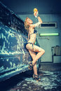 Model at the car wash in garage Royalty Free Stock Photo