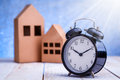 Model of cardboard house with alarm clock Royalty Free Stock Photo