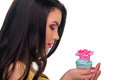Model with colorful cupcake designed eatable rose very creamy bakery s profile white background in studio Royalty Free Stock Photo