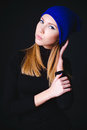 Model with creative blue make up in blue hat portrait of fashion isolated on black background Royalty Free Stock Image