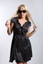 Model in dress wearing sunglasses Royalty Free Stock Images