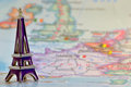Model of the eiffel tower on a background map france Royalty Free Stock Photos