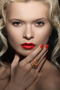 Model face red lips make up manicure jewelry ring beauty portrait of with bright and big cocktail blond curly hair retro evening Stock Image