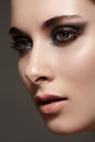 Model with fashion catwalk make up purity skin hairstyle portrait of luxury woman dark on gray background Stock Photos