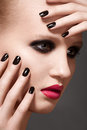Model with fashion lips make-up and nails manicure Stock Photo