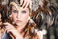 Model with feather headdress beautiful Royalty Free Stock Photography