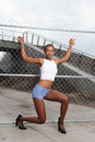 Model on the fence stock image of a young black posing Stock Images