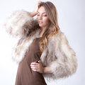 Model in fur coat an image of a gorgeous woman a beige Stock Photos