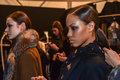 A model getting ready backstage at the Nicole Miller fashion show during MBFW Fall 2015 Royalty Free Stock Photo
