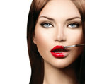Model girl applying red lipgloss beauty fashion Stock Image