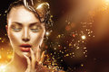 Model girl face with gold make-up and accessories Royalty Free Stock Photo