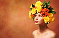 Model Girl with Flowers Hair. Hairstyle. Fashion Beauty Woman
