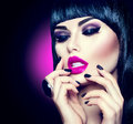 Model girl with trendy fringe hairstyle, makeup and manicure