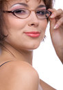 Model in glasses smilimg brunette looks over her shoulder and checks her Royalty Free Stock Image