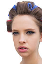 Model with hair curlers in close up pretty young on white background Royalty Free Stock Photo